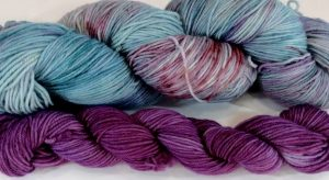 skein and mini skein of yarn in complimentary colors
