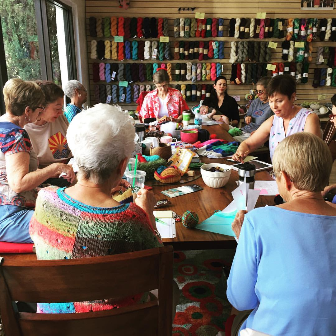 group of knitters around the table for close knit