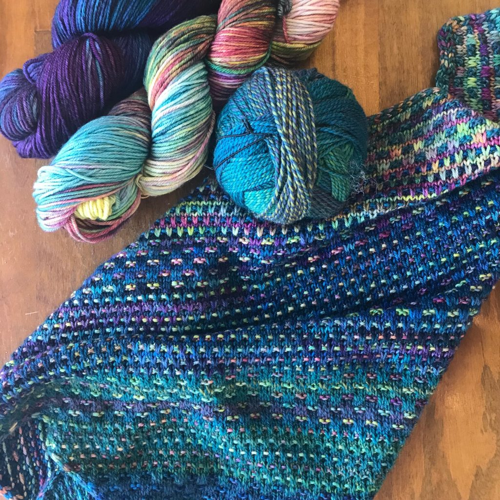 knit cowl in blues, greens and purples