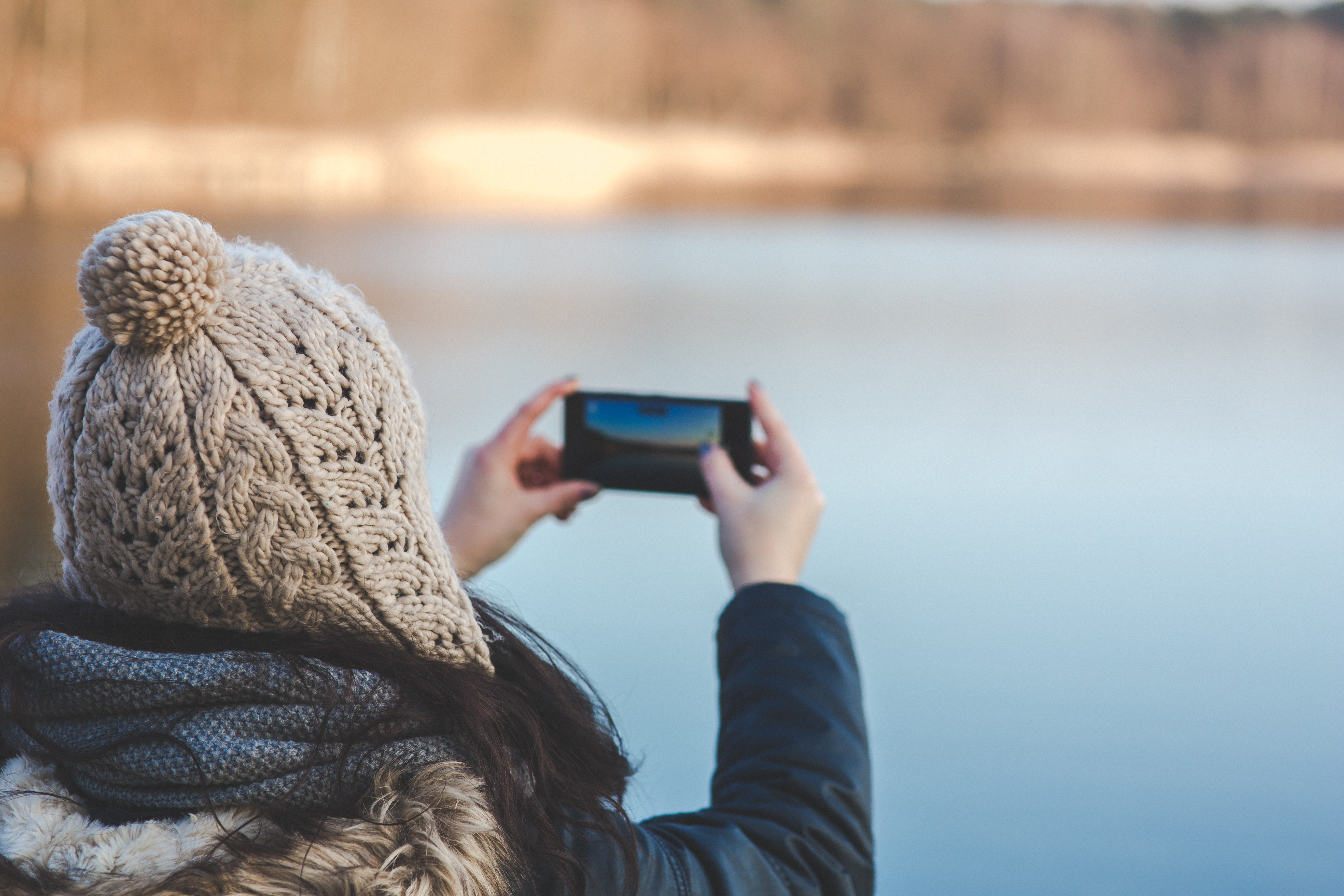 Picture of woman taking selfie with knit hat
